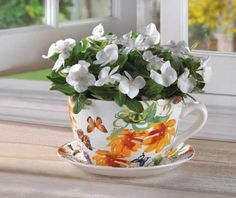 "Any gardener who's thirsty for fun will love this ""tea-riffic"" accent! Whimsical oversized cup and saucer feature a bright butterfly print and drain hole in bottom; just add a plant for effortless outdoor charm. Tea Cup Planter, Tea Pots, Planter Pots, Flower Planters, Garden Planters, Flower Pots, Outdoor Planters, Teacup Flowers, Floral Flowers"