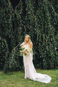 Weeping Beech at Happy Valley Norfolk - Bride Hannah wore a delicate lace gown by designer Jane Bourvis for her rustic and whimsical woodland wedding. Photography by Red on Blonde.
