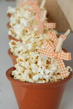 Cute popcorn idea for a tea party - (Popcorn for each girl while watching Alice in Wonderland...)