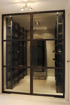 Modern wine cellar by Grand Johnson : this would make for a beautiful pantry Glass Wine Cellar, Wine Cellars, Caves, Townhouse Interior, Wine Display, Billiard Room, Wine Cabinets, Tasting Room, Wine Storage