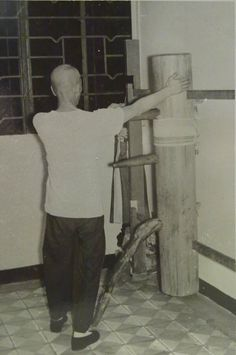 Wing Chun Grandmaster Ip Man practicing on a wooden dummy in 1967.6