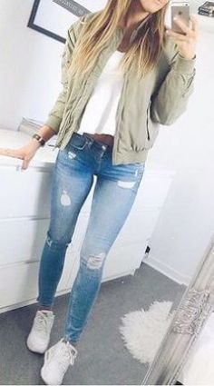 I love these fall winter outfit ideas that anyone can wear teen girls or women. The ultimate fall fashion guide for high school or college. Cute simple look with ripped blue jeans sneakers and a green bomber jacket. #rippedjeanswomenwinter
