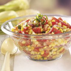 Tomato Corn Salad, I had a version of this salad in Texas at Rooster's Roadhouse and boy was it good.  This seems to be the same ingredients, gonna give it a try.