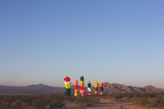 The very first stop (after late night tacos + coffee in Los Angeles) on 2017's road trip out west was the Seven Magic Mountains. I'm going to assume if you use instagram, you've probably seen one… or fifty billion photos of these incredibly colorful boulders. This art installation in the middle of the desert opened up in May of 2016 and from the second I saw it I was in