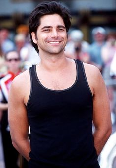 In a tank top: sexy. | John Stamos Is The Sexiest 50 Year Old Ever