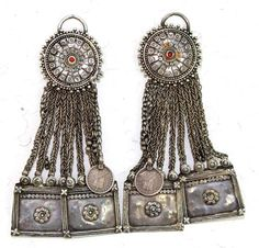 Northern Pakistan or Turkmenistan | Ear ornaments were designed to be attached to the sides of a headdress. | ca. early 20th century | Weighing a total of 124.75 grams of very high grade silver, the  coins are silver Indian quarter rupees, stamped George V King and Emperor and dated 1918. | 895$