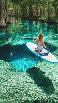 """Ginnie Springs, FL. Fun fact, that cave below her is called """"Devil's Eye."""" There's also a """"Devil's Ear"""" nearby, and 40 miles south you can find """"Devil's Den,"""" a spring underground in a huge cavern where you can swim. It's beautiful. Paddle Boarding, Good Vacation Places, I Need Vacation, Dream Vacations, Vacation Spots, Crystal River, Ginnie Springs Florida, Places To Go, Ocean Photography"""