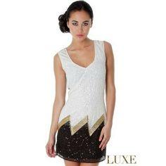 Vestito corto scollato in chiffon con perline e cristalli  Taglie s e m  https://www.lorcastyle.it
