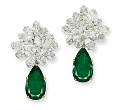 A PAIR OF EMERALD AND DIAMOND EARRINGS, BY BULGARI  The pear-shaped emeralds, weighing 6.38 and 6.30 carats, suspended from pear and marquise-shaped diamond clusters, mounted in platinum, 4.1 cm high