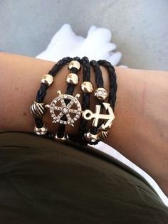 In+this+piece,+you+have+the+symbol+of+faith,+strength,+stability,+direction,+and+leadership.+This+five+row+braided+faux+leather+bracelet+is+adorned+with+gem+paved,+gold+tone+helm+charm,+beads+and+an+anchor.+Toggle+closure. Ships+free!+