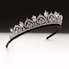 A pear shape and palmette scroll tiara set with pear and brilliant cut Swarovski crystals mounted on a palladium plated bronze frame. For further details visit www.andrewprince.co.uk Ref H2A1102