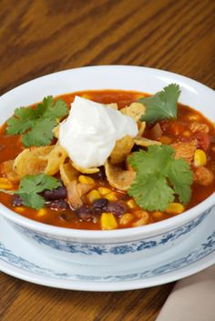 This delicious and healthy chicken soup recipe features chicken, cheese, black beans, garlic, rice, jalapenos and more. For a real taste of Mexico, you cannot go wrong with this easy Mexican soup recipe. This is quite a nutritious recipe because it is low in fat, yet high in protein and vitamin content.