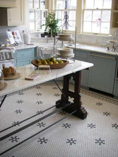 mosaic tile floors with decorative elements - butler's pantry?