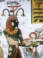 Hapi, the ancient Egyptian god of the Nile, wearing the fish standard of a local nome.