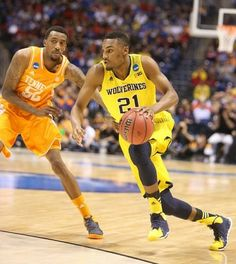 Michigan's Zak Irvin drives against Tennessee's Jordan McRae during second half action of the NCAA Midwest Regional Tournament game.