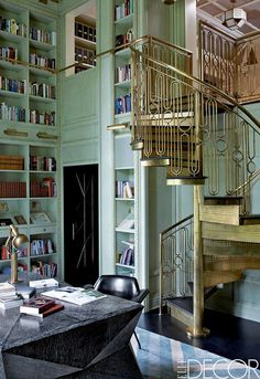 opulent library: mint walls & gold spiral staircase