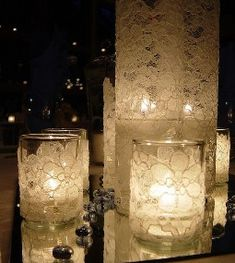 Wedding- DIY cheap and easy Wedding table decoration, sheer lace wrapped around a plain glass candle holder and vase.Can be used for wedding centerpieces or aisle decor. Candle Wedding Centerpieces, Diy Candles, Lace Candles, Centerpiece Ideas, Floating Candles, Flameless Candles, Lace Wedding Decorations, Cream Candles, Winter Centerpieces