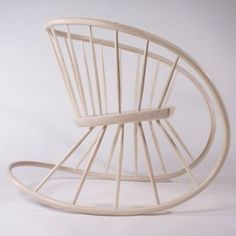 The Windsor Rocking Chair is created by a single continuous band of steam bent ash with solid seat supported by turned spindles. It was exhibited in Collect 2011 with Contemporary Applied Arts, appeared on the Wesley Barrell Craft award shortlist in 2011, and has won the Wood Awards Furniture also in 2011.