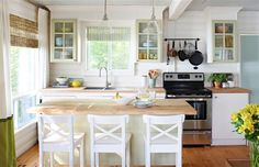 Paint, especially in the sticks, will unify mismatched cabinet doors in a charming way. In our city homes we have higher expectations and want fancy finishes. That's the good news about the country: You can get away with banged-up cabinets and counters and they'll look rustic.