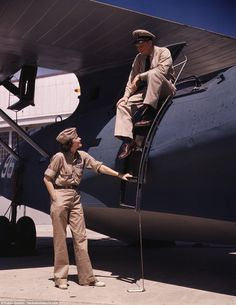 Mrs. Eloise J. Ellis, senior supervisor in the Assembly and Repairs Dept. of the Naval Air Base, talking with one of the men, Corpus Christi, Texas