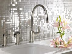 These silver mosaic tiles add a touch of class to your kitchen renovation. In any tile design, the grouting is important. For mosaic tiles, match the grout for best results. - See more at: http://www.bluetea.com.au/blog/tile-splashbacks/#sthash.Uyw51tNt.dpuf