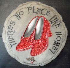 """$19.95 + calculated (global) shipping ~ Garden/Yard Decorative Stepping Stone features Ruby Red Slippers & Wizard of Oz saying,""""There's No Place Like Home"""", by Spoontiques.  There's a opening on back for the option of hanging on an interior wall of the home.  ~~see over 20 categories of merchandise in my store. www.shellyssweetfinds.com"""