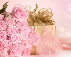 Any girl would be delighted to be given a gold wrapped box and a huge bunch of pink roses.