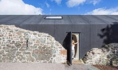 Futuristic solar home hidden inside 18th-century stone ruins