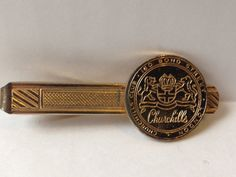 1960's Churchills Club membership token tie clip. Gold plated. The notorious Churchills Club in London's Bond Street opened in the 1960s and was run by Bruce Brace and Harry Meadows in association with south London gangster Billy Howard. The Club featured a burlesque type show with singers and dancers. When Harry Meadows gained full control of the club, he gave these token items out to elite customers to use as 'Membership Tokens' so they could get in for free.