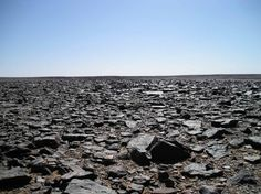 The black desert in the Libyan Sahara - Desert varnish makes the rocks go black - (c) followmefaraway.com