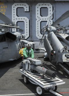 PACIFIC OCEAN (April 23, 2013) Aviation Machinists Mate 1st Class Samuel Davis, from Chicago, moves an M-197 20mm gun on the flight deck of the aircraft carrier USS Nimitz (CVN 68). Nimitz and Carrier Air Wing 11 recently left San Diego for a Western Pacific deployment. (U.S. Navy Photo by Mass Communication Specialist 3rd Class Chris Bartlett/Released)
