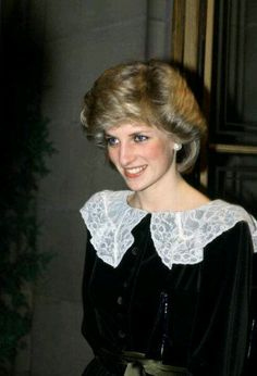 Diana - did you notice how often she wears white or something with a white collar around her face? It reflects the light from all the flashbulbs!