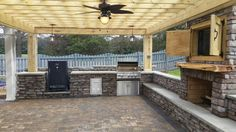 400 sqft of 3 stone Pavestone Paver patio  Stone veneer outdoor kitchen with built in grill  Smoker  Stone veneer sitting wall with back rest  Concrete counter tops  Stone veneer fireplace and TV Pergola with columns  Outdoor lights   Charlotte NC