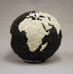 This pin links to an artist Bart Vargas' page which includes the peices he has created with old computer materials. He uses old keyboards and cords to create unique new art pieces, including globes, a skull, a map and many more.