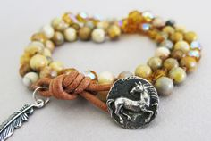 One Happy Horse Knotted boho triple wrap bracelet made with crazy lace agate. Crazy lace agate is knotted with randomly placed topaz Czech beads to make a bracelet that wraps around your wrist three times. The bracelet closes with leather and a handcrafted horse button.