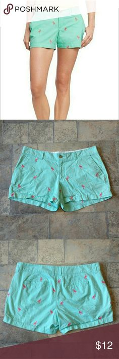 "EUC! Adorable Old Navy mint green flamingo shorts These Old Navy shorts are in excellent condition. Mint green with bright pink flamingos all over. Two pockets in front, two in back. Button and zipper closure. Size 10. Waist measures 17"" laying flat. Length from waist to bottom hem is approx. 11"". 100% cotton. Any questions, just ask! Old Navy Shorts"