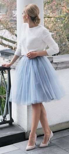 Women's fashion | White sweater, low bun and blue tulle skirt