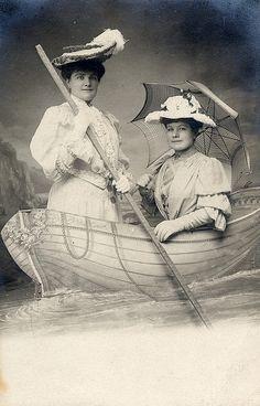 +~+~ Antique Photograph ~+~+  Souvenir photograph at Paris and Terrase de la Mer, Carbourgh.  Two elegant French ladies in a faux boat.  August 1905