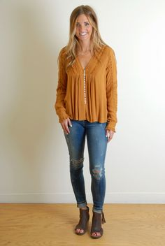 Just got this! I'm a bit obsessed with this color lately. The shirt has so many details. It does run a little large and it's supposed to fit very loose, but I went down one size. (Free People Meet Me Half Way Top)