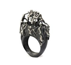 Hey, I found this really awesome Etsy listing at https://www.etsy.com/listing/88335128/istanbul-ring-comes-with-climbing-man Very,very.. unique.. artistic designs !