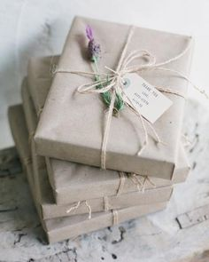 Rustic packaging...brown paper package with twine and a hand-stamped tag