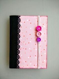 Cuadernito bolso,de lunares rosas.