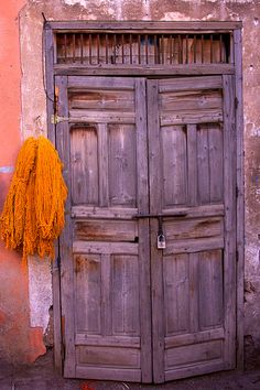 Africa Marrakech Door in the Dyers Souk © Marcus Beard. I love this image, the worn door, the wall and the drying dyed yarns. The colours and composition too.