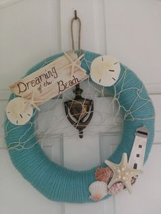 Are you looking to decorate your beach house? Or just dreaming of the beach? This wreath will be the perfect compliment to any beach or seaside theme