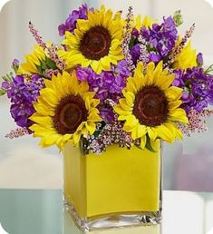 "Sunflower Bouquet with ""yellow"" in container."