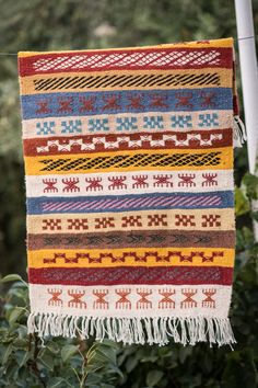 This is a Tunisian Vintage Style Handwoven Margoum Kilim Rug, made with natural wool in berber style.Showcasing berber multicolore ethnic diagrams in alternate stripes and medium raw surface finishing. Berber Rug, Vintage Fashion, Vintage Style, Kilim Rugs, Hand Weaving, Stripes, Tapestry, Kilims, Wool