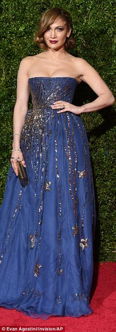 Stunning: The 45-year-old entertainer shut down the red carpet in a strapless navy ensembl...