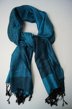 This favorite has a classy look that is evident from a mile away! Made of a cashmere-silk blend, this scarf's beautiful sheen separates it as a superior quality accessory. You will also love the soft feel of the cashmere wool against your skin. Available in blue, fuchsia, beige, orange, gray, red and brown. #scarf #scarves #fallscarves #giftsforhim #giftsforher #gifts #holidays #gifting