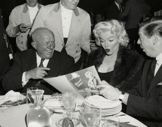 "Marilyn Monroe with Arthur ""Bugs"" Baer and Milton Berle at the Banshees Award Luncheon, Waldorf Astoria Hotel, New York, April 26th 1955."