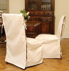 DIY Chair cover ideas but with a ribbon or bow over? What if it is two pieces? One long to cover the back and then another piece to cover crossing to cover the sides? Buttons to hold in place?